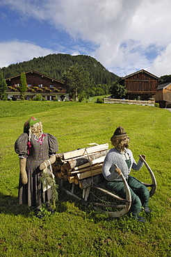 Scarecrows outside a house near Ramsau, Berchtesgaden, Bavaria, Germany, Europe