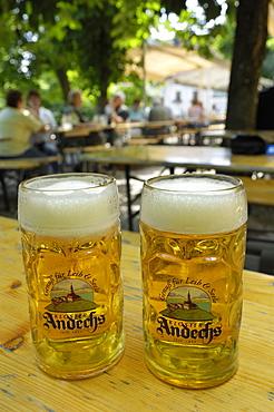 Beer steins in Andechs beer garden, brewed in the monastery, Andechs, near Munich, Bavaria, Germany, Europe