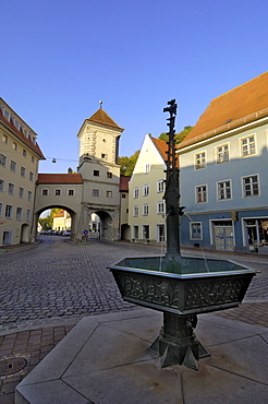 Fountain and the Sandauertor (Sandau Gateway) in the city walls, Landsberg am Lech, Bavaria (Bayern), Germany, Europe