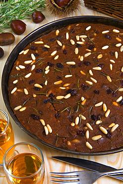 Castagnaccio, pie of chestnut flour with raisins, rosemary and pine nuts, Tuscany, Italy, Europe - 765-1204