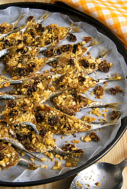 Sicilian style anchovies, with crushed almonds, raisin, grated bread, seeds of wild fennel, olive oil, pepper, cooked in the oven, Sicily, Italy, Europe