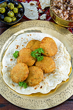 Falafel, a deep-fried balls or patties made from ground chickpeas and or fava beans, Arabic Countries