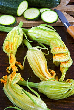 Courgette flowers and sliced courgette, Italy, Europe