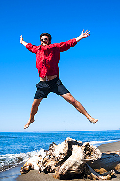Jumping close to sea, Capalbio beach, province of Grosseto, Tuscany, Italy, M.R.