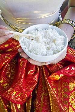 Hands holding a bowl of rice, Thailand, Southeast Asia, Asia