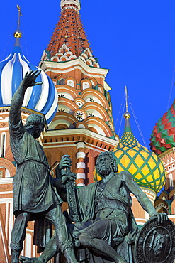 Minin and Pozharskiy statue and the St. Basil's Cathedral in Red Square illuminated in the evening, UNESCO World Heritage Site, Moscow, Russia, Europe