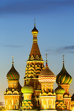 The onion domes of St. Basil's Cathedral in Red Square illuminated at night, UNESCO World Heritage Site, Moscow, Russia, Europe