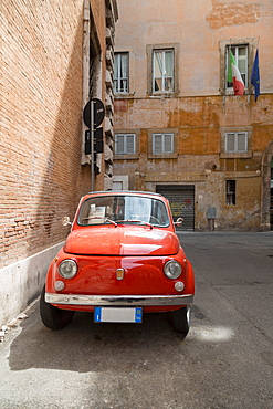Small old Fiat 500 car parked on a back street in Rome, Lazio, Italy, Europe
