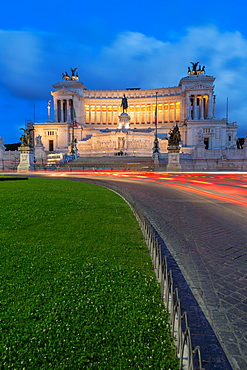 Moving traffic around Piazza Venezia with the Victor Emmanuel Monument at night, Rome, Lazio, Italy, Europe