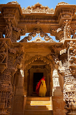 Indian lady in traditional dress in a temple in Jaisalmer, Rajasthan, India, Asia