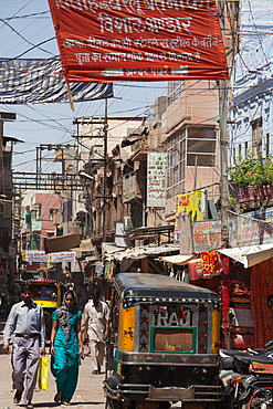A narrow busy street in the city of Jodhpur, Rajasthan, India, Asia