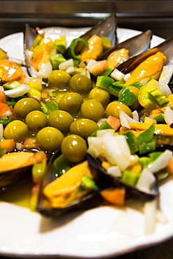A plate of mussels and olives at a traditional tapas bar in Madrid, Spain, Europe