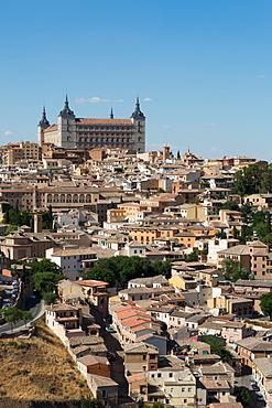 The Alcazar towering above the rooftops of Toledo, UNESCO World Heritage Site, Castilla la Mancha, Spain, Europe