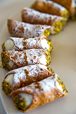 Traditional Sicilian Cannoli arranged on a plate, Sicily, Italy, Europe