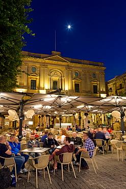 Night time outdoor restaurants in Piazza Regina in Valletta, European Capital of Culture 2018, Malta, Mediterranean, Europe