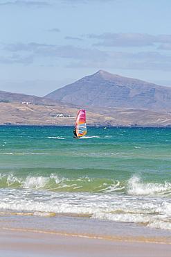 Wind-surfer off Playa de La Barca, Costa Calma, on the volcanic island of Fuerteventura, Canary Islands, Spain, Atlantic, Europe