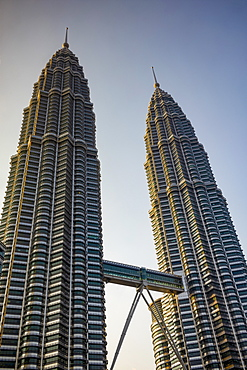 The iconic 88 floor Petronas Twin Towers, connected by a skybridge, designed by Cesar Pelli, in the capital city of Kuala Lumpur, Malaysia, Southeast Asia, Asia
