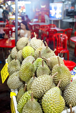 A display of Durian fruit for sale in Bukit Bintang food street at night in the capital city of Kuala Lumpur, Malaysia, Southeast Asia, Asia