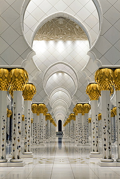 Gilded columns leading to the main prayer hall of Sheikh Zayed Bin Sultan Al Nahyan Mosque, Abu Dhabi, United Arab Emirates, Middle East