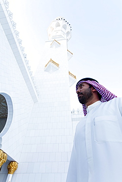 Man entering the main prayer hall of Sheikh Zayed Bin Sultan Al Nahyan Mosque, Abu Dhabi, United Arab Emirates, Middle East