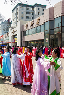 Women in traditional dress dancing during street celebrations on the 100th anniversary of the birth of President Kim Il Sung, April 15th 2012, Pyongyang, Democratic People's Republic of Korea (DPRK), North Korea, Asia