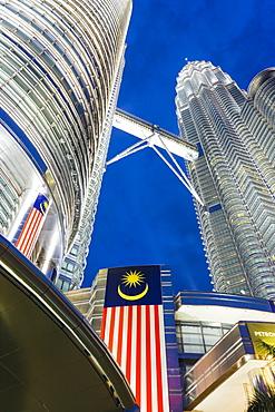Petronas Towers and Malaysian national flag, Kuala Lumpur, Malaysia, Southeast Asia, Asia
