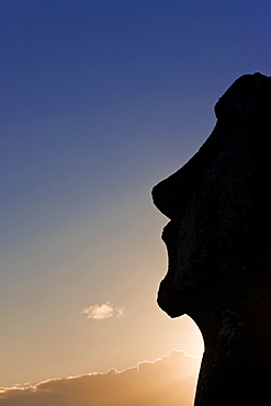 Silhouette of a lone monolithic giant stone Moai statue at Tongariki, Rapa Nui (Easter Island), UNESCO World Heritage Site, Chile, South America