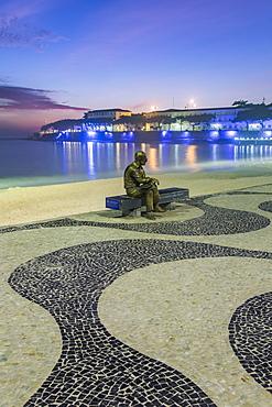 Brazilian poet Carlos Drummond de Andrade statue at Copacabana beach sidewalk, Rio de Janeiro, Brazil, South America