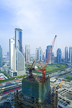 Modern skyscrapers and new construction in the Lujiazui financial district of Pudong, Shanghai, China, Asia