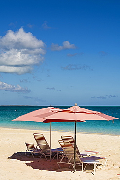 Beach umbrellas on Grace Bay Beach, Providenciales, Turks and Caicos Islands, West Indies, Central America