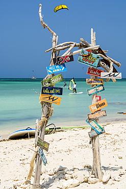 Windsurfing and signs at Hadicurari Beach, Aruba, ABC Islands, Dutch Antilles, Caribbean, Central America