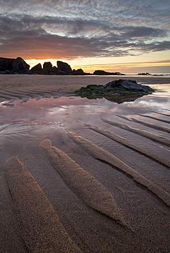 Sunset over Porthcothan Beach in North Cornwall, England, United Kingdom, Europe