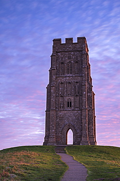 St. Michael's Tower on Glastonbury Tor at dawn in winter, Glastonbury, Somerset, England, United Kingdom, Europe