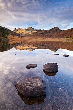 The Langdale Pikes mountains reflected in the mirror still water of Blea Tarn, Lake District National Park, Cumbria, England. Autumn (November) 2016.