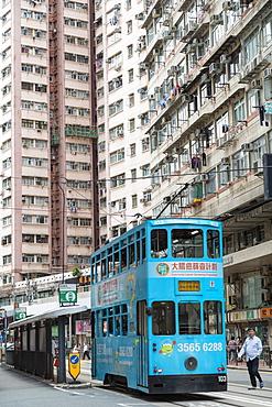 Trams at tram stop, Sai Ying Pun, Hong Kong Island, Hong Kong, China, Asia