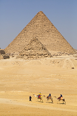Tourists riding camels, Great Pyramids of Giza, UNESCO World Heritage Site, Giza, Egypt, North Africa, Africa