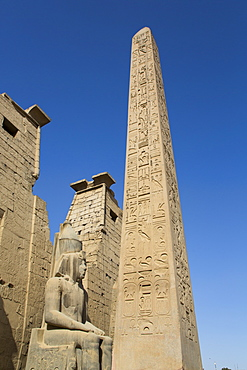 Colossus of Ramses II in front of Pylon, Obelisk, Luxor Temple, UNESCO World Heritage Site, Luxor, Thebes, Egypt, North Africa, Africa