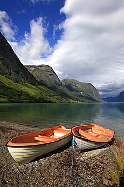 Boats pulled up on the shore of a fjord in the Fjordland region, western Norway, Scandinavia, Europe