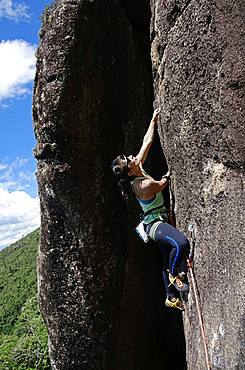 Rock climber in action at Anhangava, Curitiba, Brazil, South America