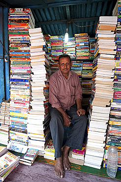 College Street bookstall holder, the world's largest second hand book market for intellectuals, scholars, and students, Kolkata (Calcutta), West Bengal, India, Asia