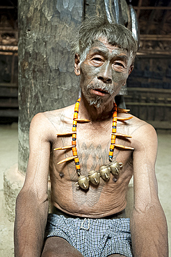Naga headhunter, Longsha Wangnao, with chest tattoo marking him as having taken a head, and Naga necklace with tiger teeth, Nagaland, India, Asia
