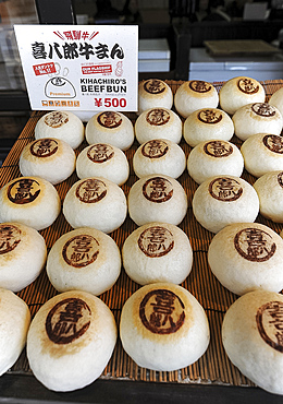 Beef buns, steamed, fluffy, soft buns with a succulent meat and vegetable filling, in fast food restaurant, Takayama, Japan, Asia