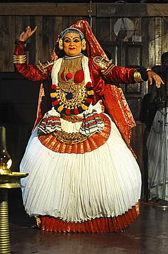 Contemporary female performer in a traditional Kathakali dance about folk mythologies from the Hindu epics, Nilambur, Kerala, India, Asia