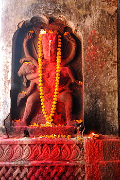 Hayagriva, horse-headed incarnation of Hindu Lord Vishnu, with garland and red powder, Hayagriva Madhava Temple, Hajo, Assam, India, Asia