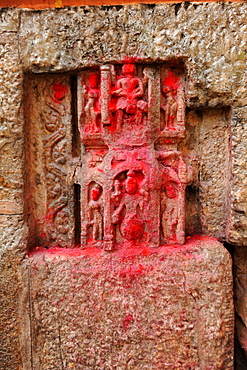 450 year old carvings of gods, blessed with red powder by Hindu pilgrims, in the walls of the Kamakhya temple, Gauhati, Assam, India, Asia