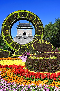Elaborate floral decorations celebrating 70 years of China framing the Bell Tower, built in 1272, Beijing, China, Asia