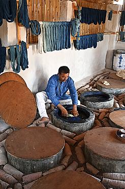 Demonstration of centuries old traditional Ajrakh indigo dyeing of skeins of locally spun cotton, Ajrakhpur, Bhuj, Gujarat, India, Asia