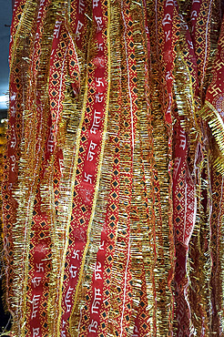 Red and gold tinselled cloths for Hindu devotees visiting a temple, Guwahati, Assam, India, Asia