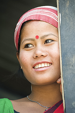 Smiling married woman from the Mishing tribe wearing typical Assamese domestically woven scarf, Majuli Island, Assam, India, Asia