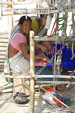 Assamese tribal village women spinning cotton at domestic loom, Majuli Island, Assam, India, Asia